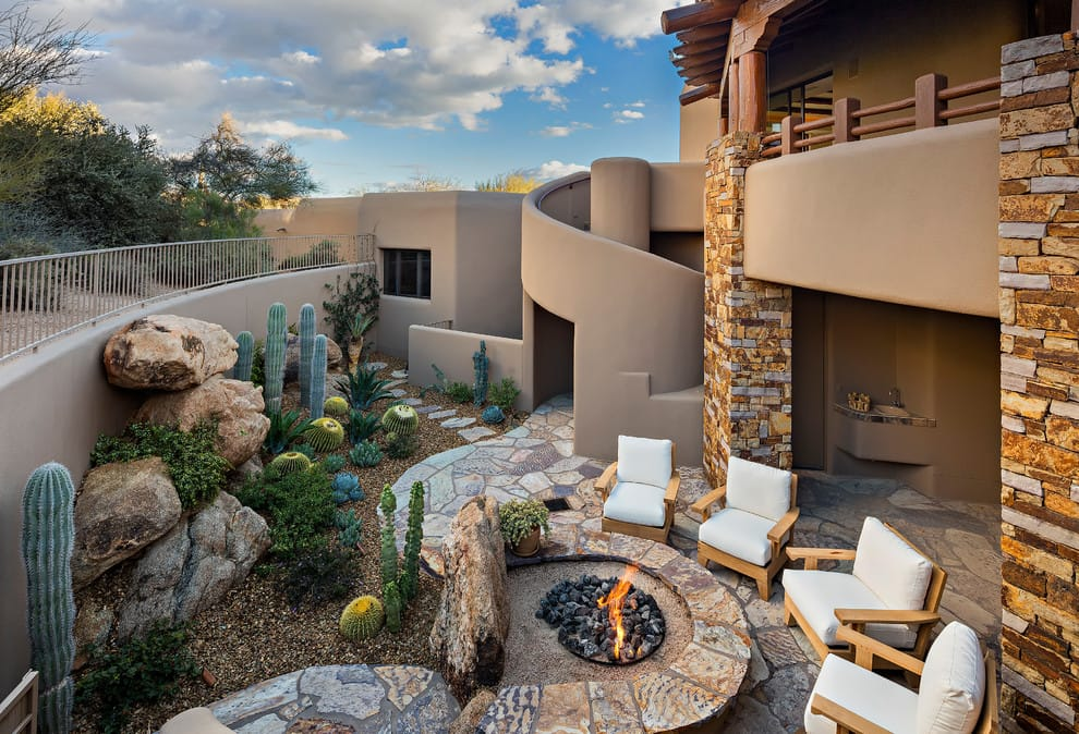 a southwest backyard patio design in Phoenix with a fire pit and no cover