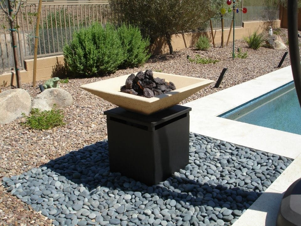 a southwestern backyard landscaping in Phoenix with a fire pit