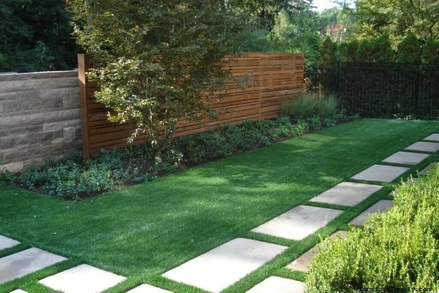 White stone and artificial backyard turf